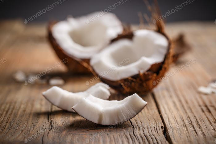 Broken raw ripe coconut