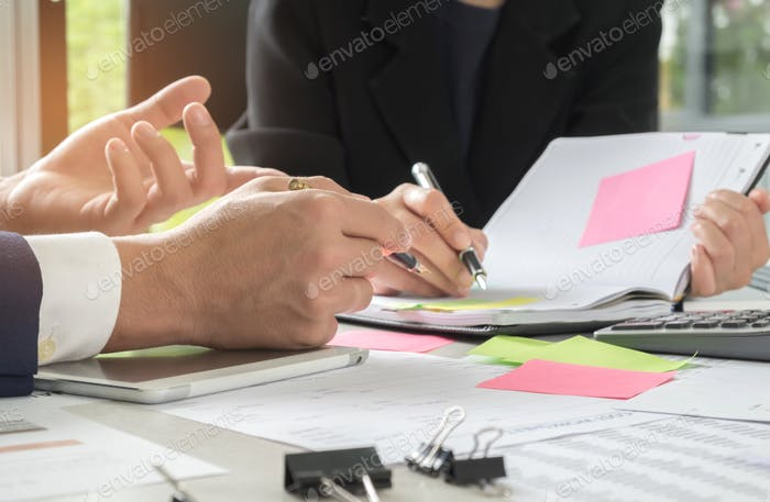 Management is executing the secretary is taking notes.Document placed on the desk.
