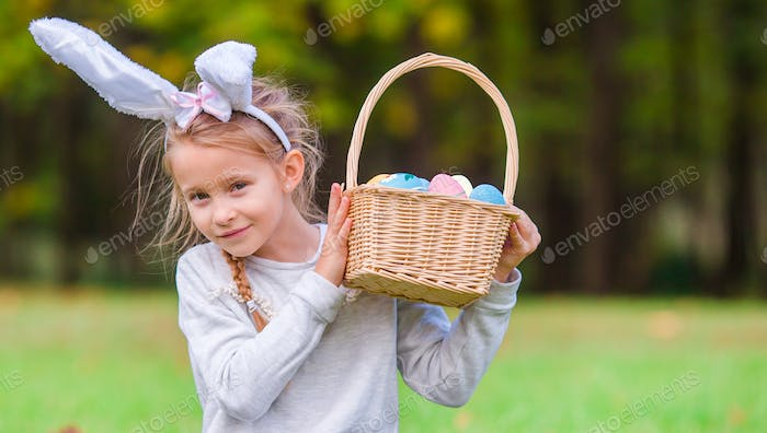 Portrait of kid on Easter with eggs outdoor