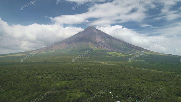 Closeup Philippines volcano haze eruption aerial. Green grass landmark of Mayon mountain