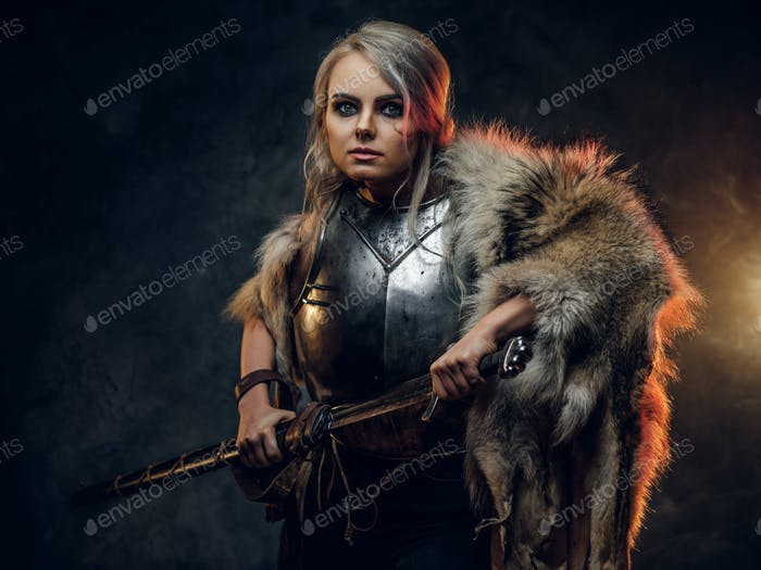 Fantasy woman knight wearing cuirass and fur, holding a sword