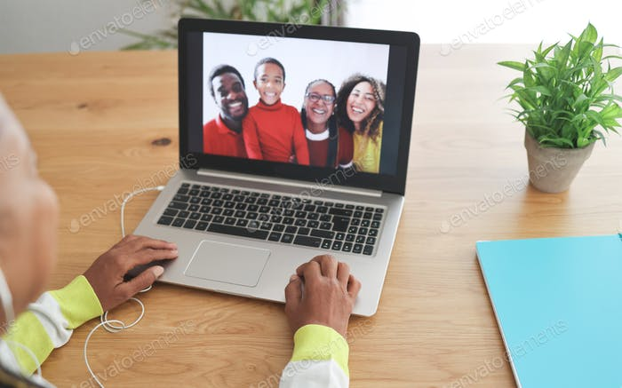 African senior woman doing video call with her family during coronavirus lockdown