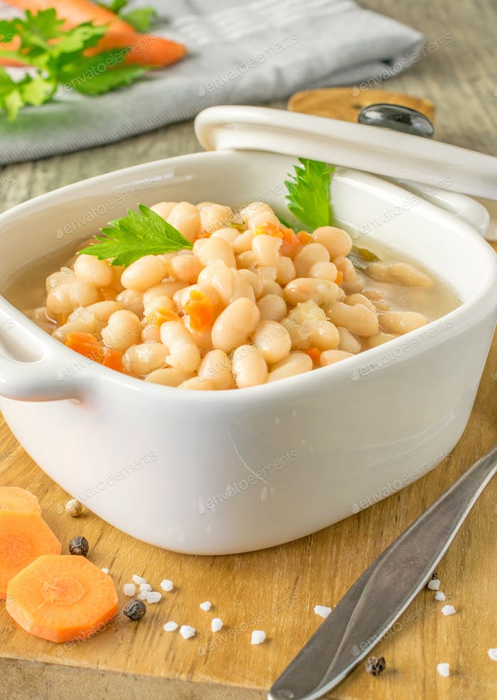 A bowl of white beans and carrot stew