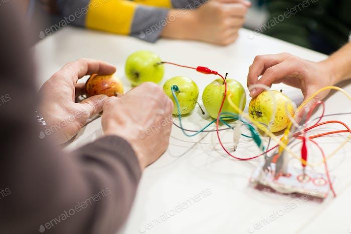 kids hands with invention kit at robotics school
