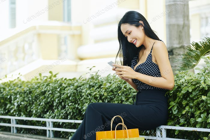 Woman communicating online on the phone
