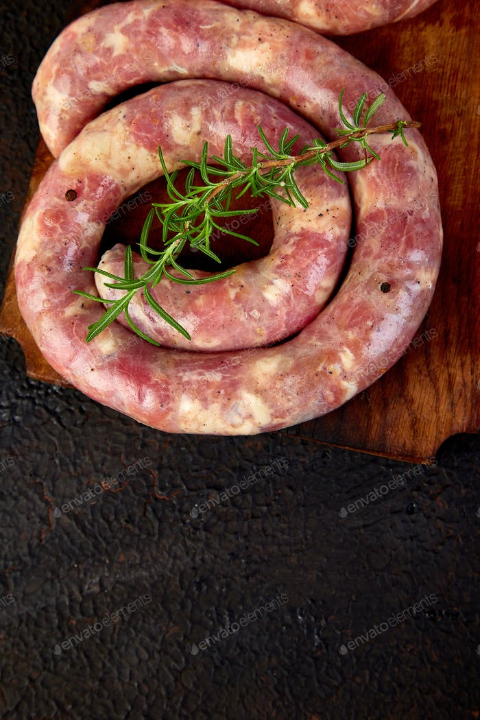 Raw spiral pork sausages