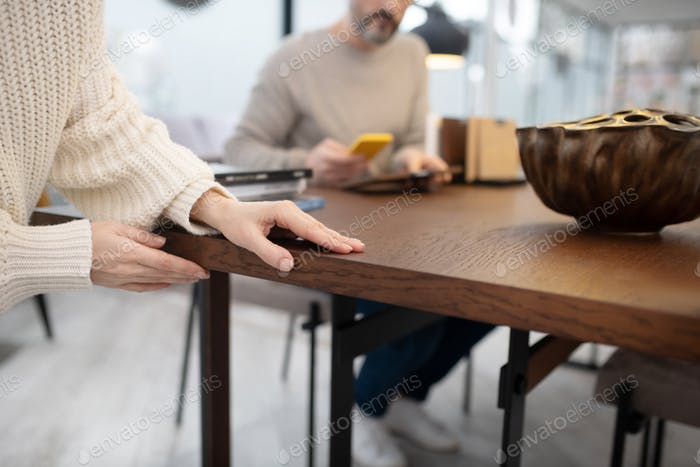 Picture of womans hands touching the table