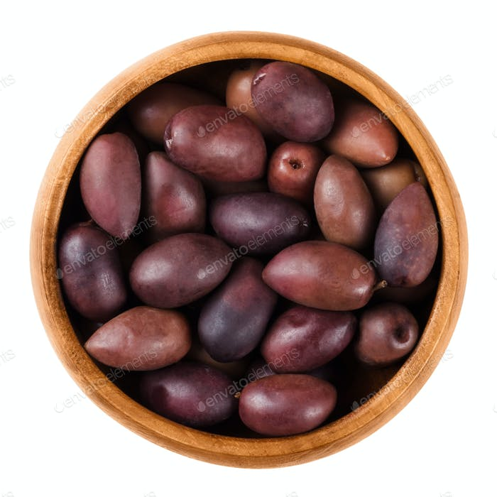 Kalamata black olives in a wooden bowl over white