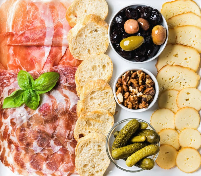 Meat and cheese snack set for wine on white background