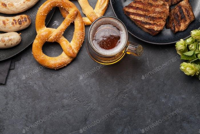 Oktoberfest set. Pretzels, meat and lager beer
