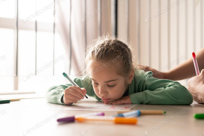 Serious girl coloring picture