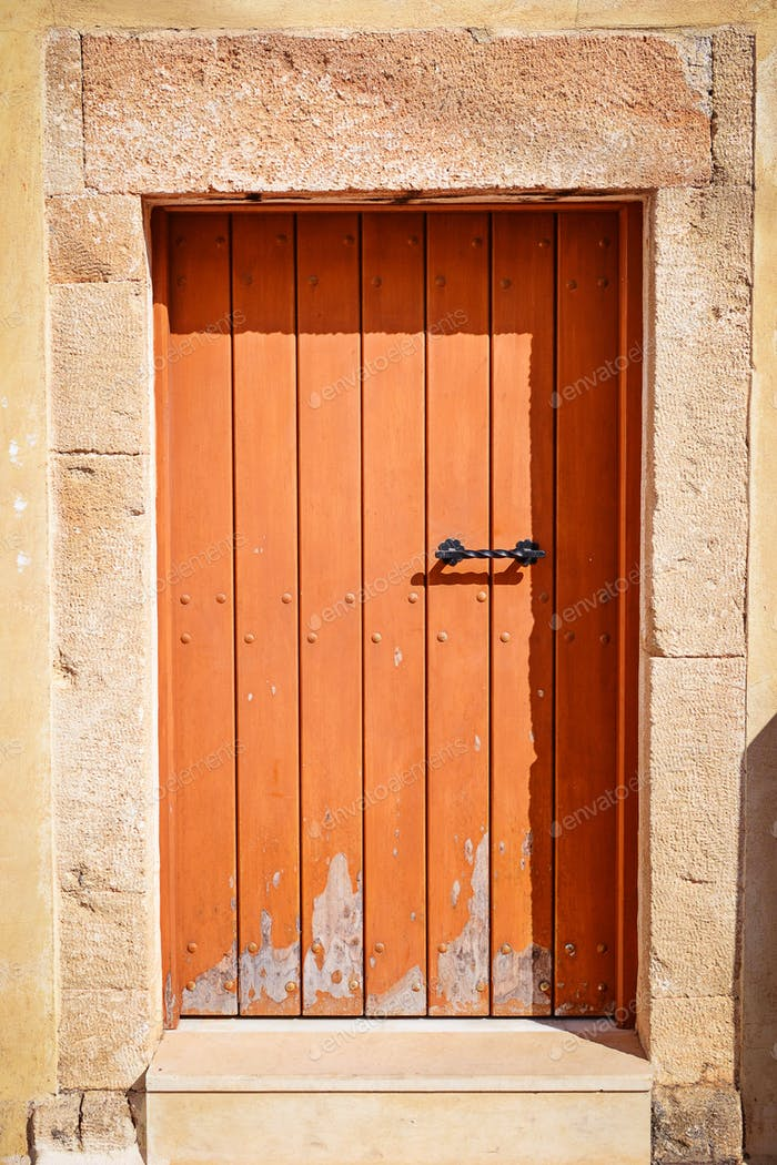 Old wooden door on Malia, Greece