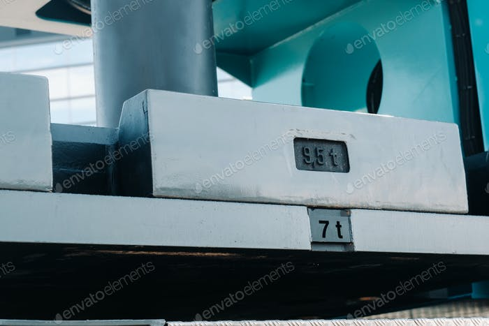 installing a counterweight on a truck crane. detail of the truck crane.Autoparts