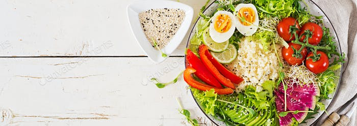 Couscous, egg and vegetables bowl. Healthy, diet, vegetarian food concept.