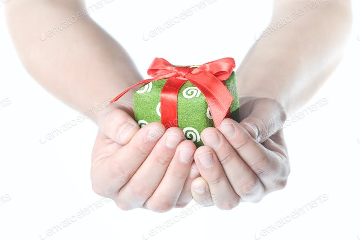 Hands holding gift isolated on white