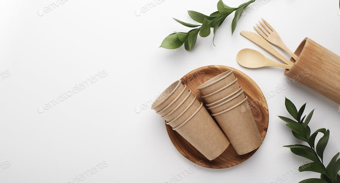 Paper cups, wooden plate and cutlery tools