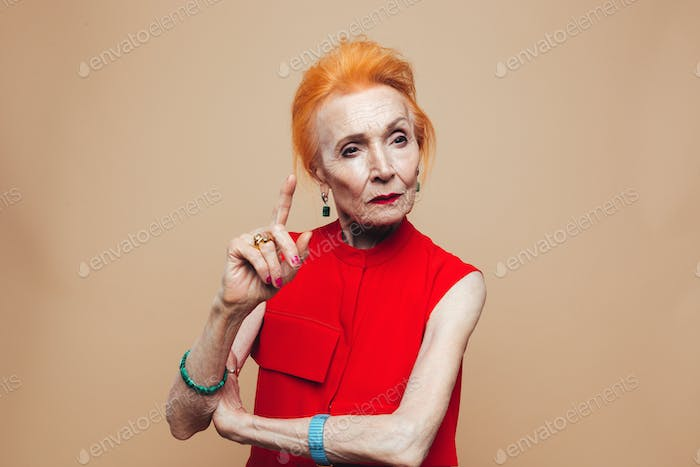 Thinking mature redhead fashion woman