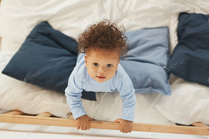 Cute Baby Playing on Bed