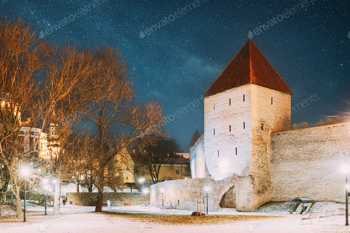 Tallinn, Estonia. Night Starry Sky Above Traditional Old Architecture Skyline In Old Town. Former