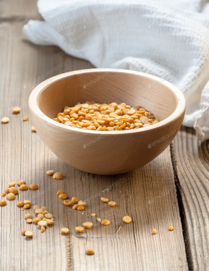 Wooden bowl on the wooden background