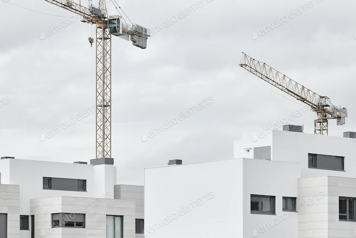 Modern building and crane machinery structure. Construction industry. Horizontal