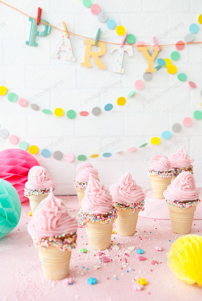 Pink soft serve ice cream with sprinkles