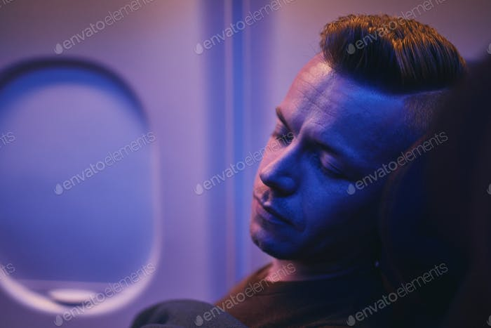 Man sleeping during flight
