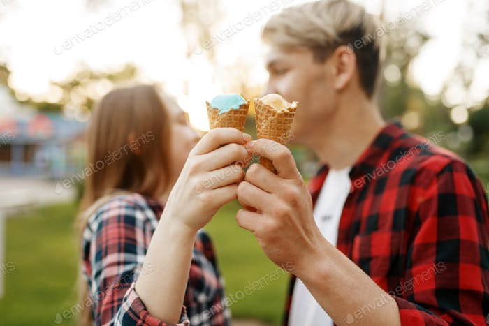 Love couple with ice cream in park, romantic youth