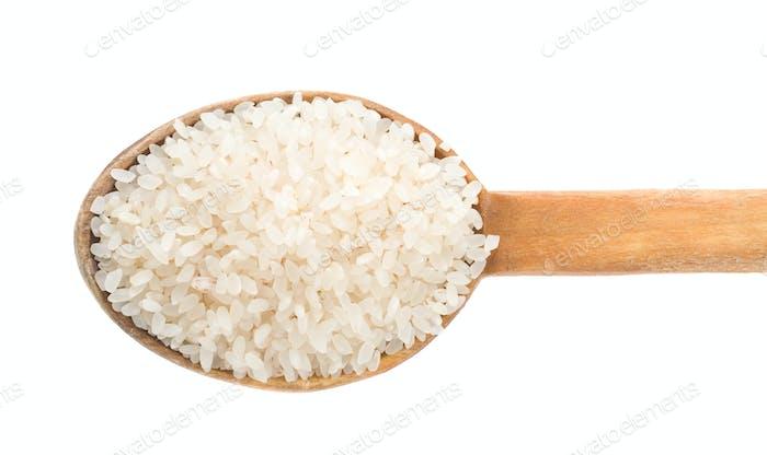 rice grain in wooden spoon