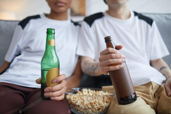 People Drinking Beer by TV