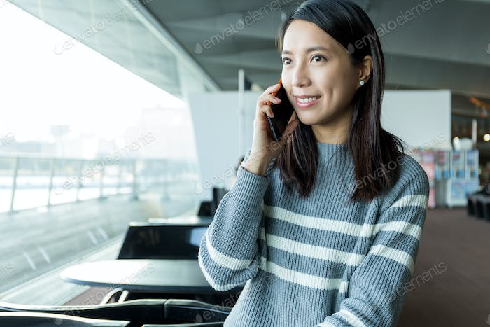 Woman talk to cellphone at restaurant
