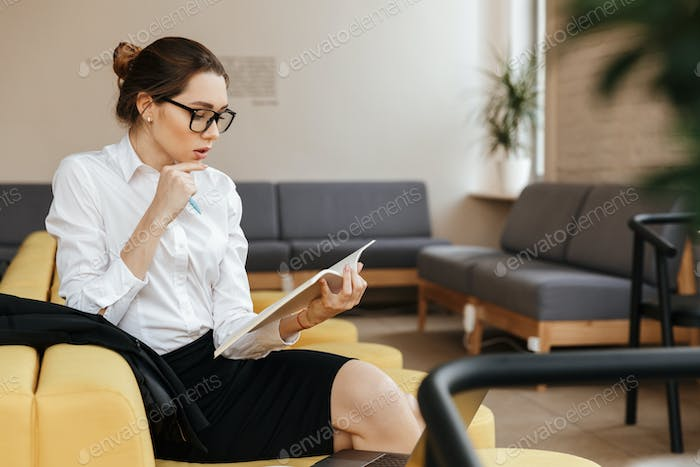 Serious business lady reading documents