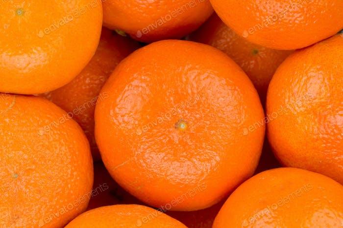 Ripe tangerine closeup background