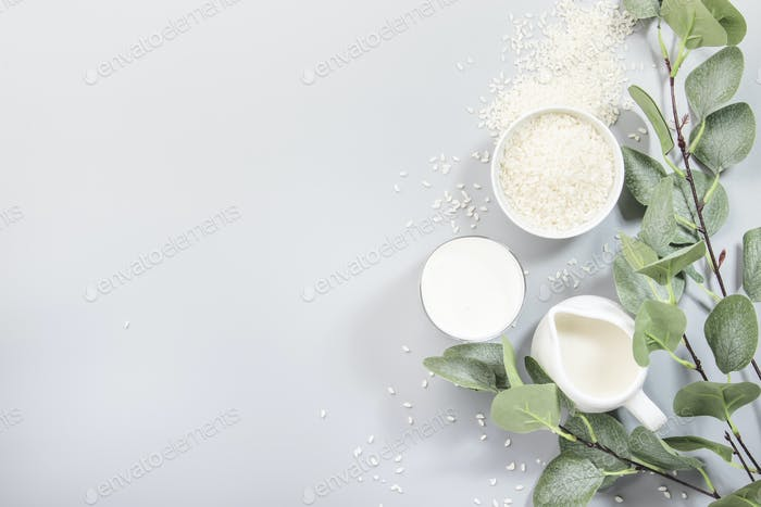 Vegan rice plant based milk in bottles, closeup
