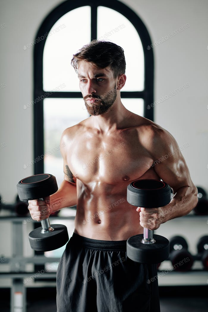 Shirtless young man doing exercise