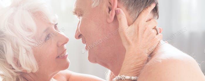 Older woman holding her husband's neck