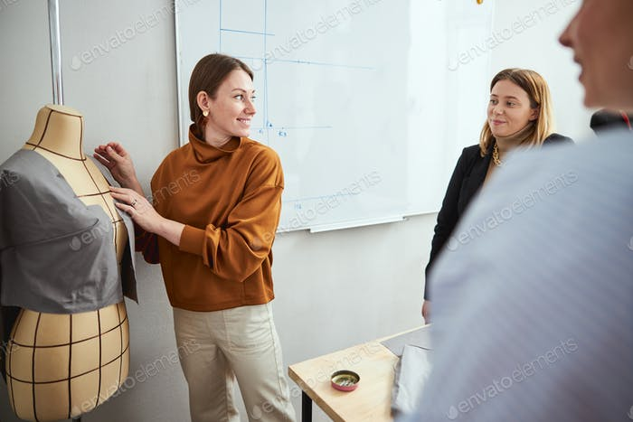 Inexperienced tailor looking for approval of teacher