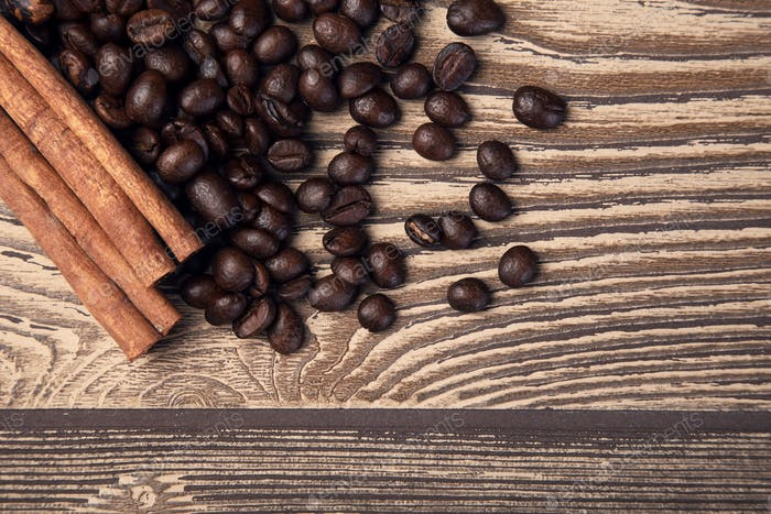 Coffee Beans And Cinnamon On Wooden Table. Top View.
