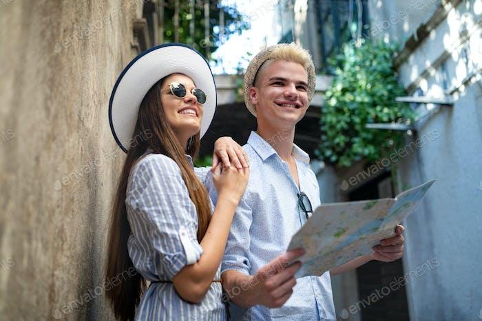 Tourist couple in love enjoying city sightseeing at summer