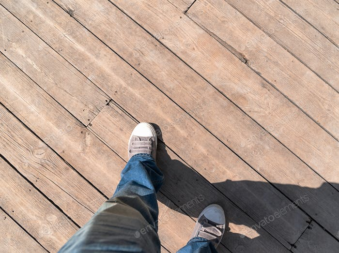 Sneaker on wooden planked floor from above-2