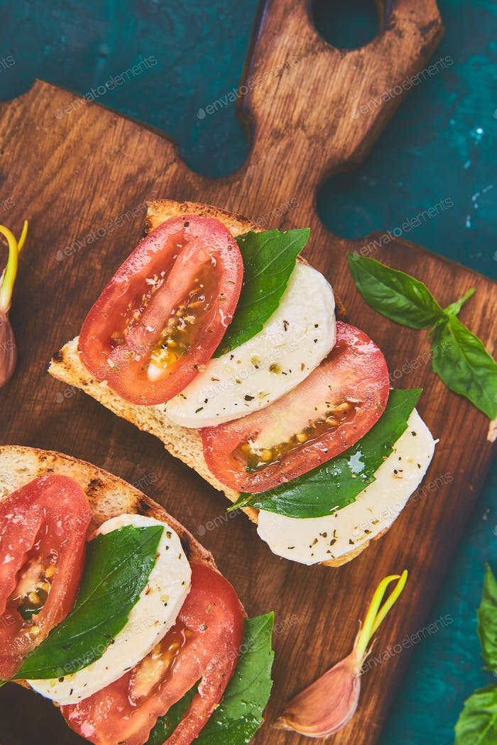 Bruschetta with tomatoes, mozzarella cheese and basil