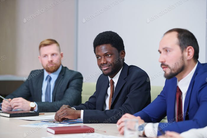 African businessman and his Caucasian colleagues or partners
