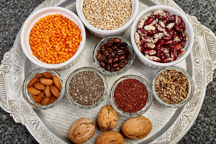 Beans and nuts selection in bowls. Healthy food