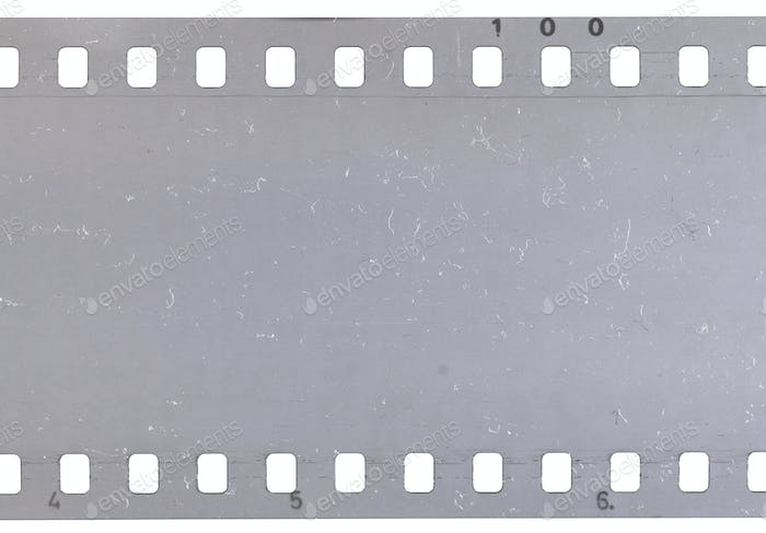 Strip of old celluloid film with dust and scratches