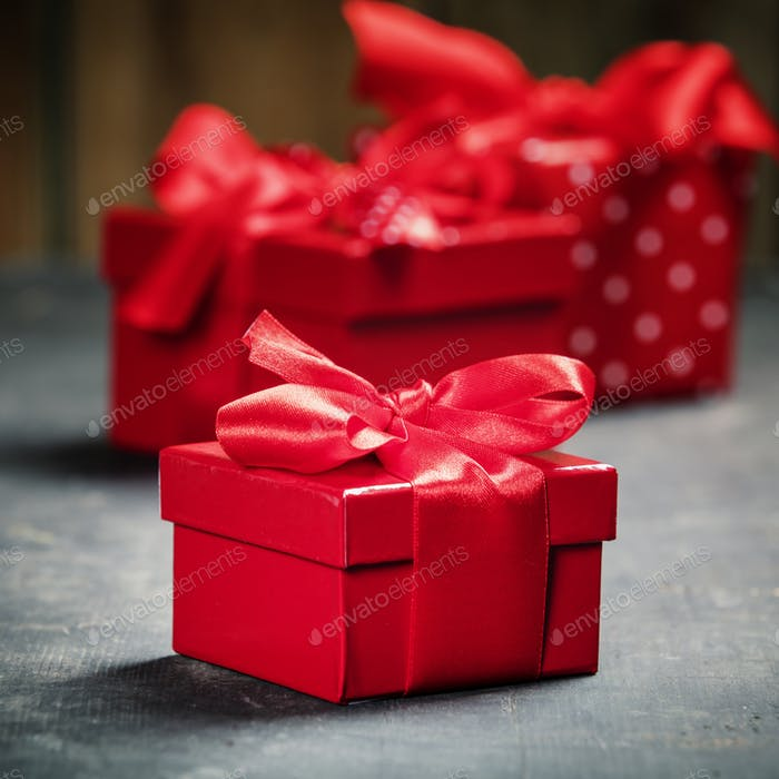 Valentine's Day concept. Gifts with red bow on the wooden background