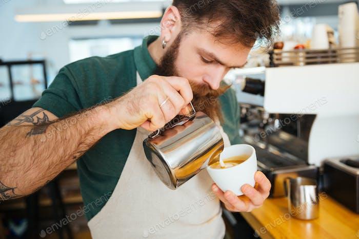 Barista making cappuccino
