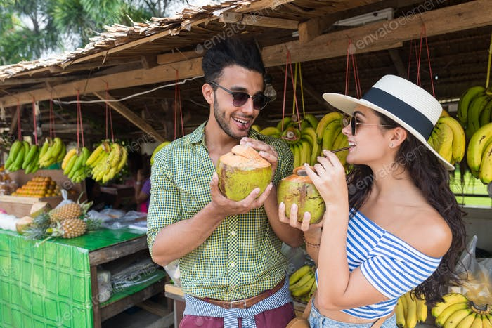 Couple Drink Coconut Cocktail On Street Traditional Fruits Market