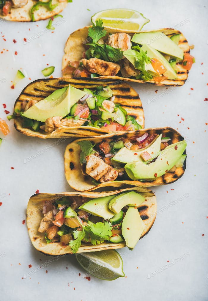 Healthy corn tortillas with grilled chicken, avocado and fresh salsa