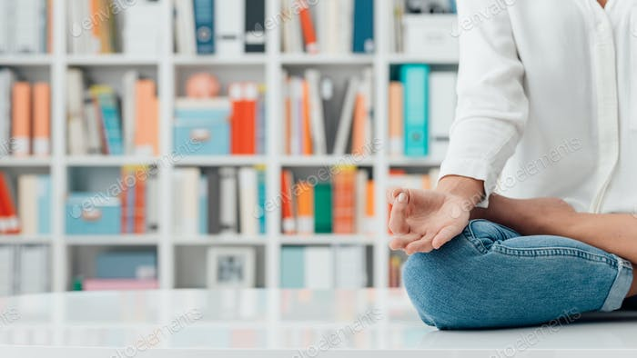 Woman practicing meditation on a desk