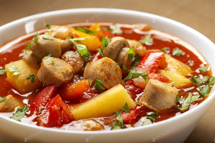 Stew or soup made from vegetables and sausages